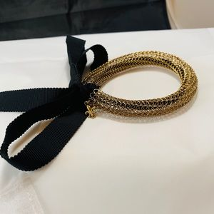 Gold Viking knit bracelet w Fleur de Lis charm